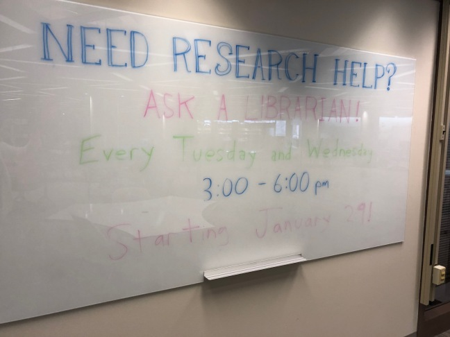 Image of a white board advertising drop-in research help.