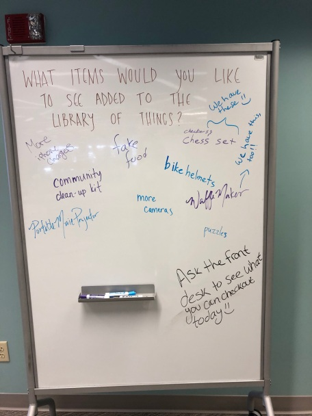 Photo of white board in the library asking patrons what they would like to see added to the library of things collection.