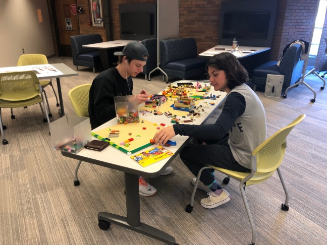 Photo of students at lego table.